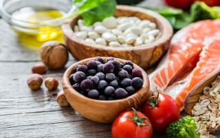 Selection of heart-healthy foods on a wooden table